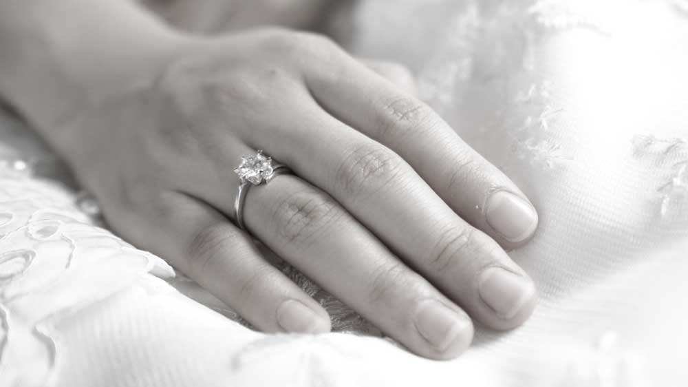Diamond Engagement Ring on Finger