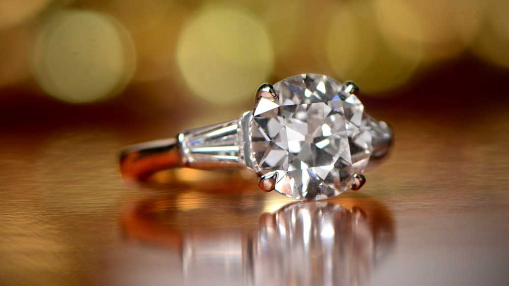 Engagement Ring with Platinum and Gold on Table