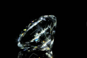 Loose diamond on black background