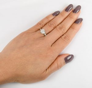 1.5 carat engagement ring on a finger