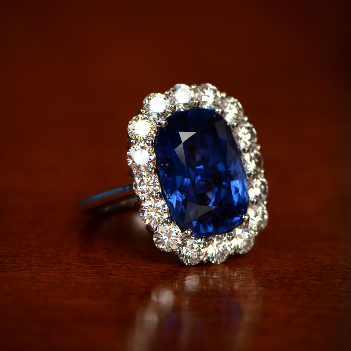 Sapphire Ring with Diamond Halo on Brown Table