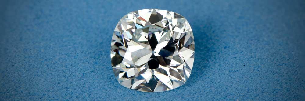 Antique Cushion Cut Diamond on Blue Background