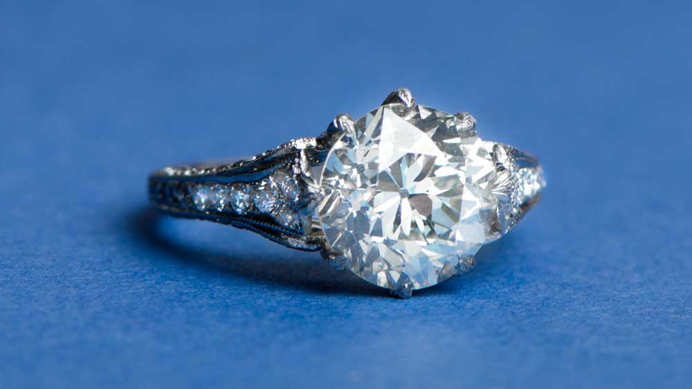 Three Carat Diamond Ring on Blue Background