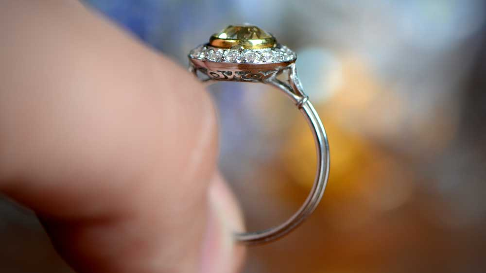 Yellow Diamond Engagement Ring Being Held