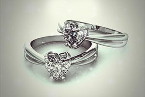 Two heart-shaped diamond engagement rings