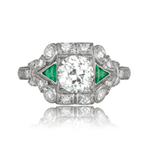 an art deco diamond engagement ring with emerald accents