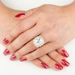 Woman's hands with vintage diamond engagement ring