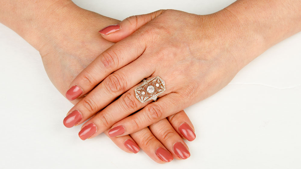 Elongated Diamond Ring on Finger