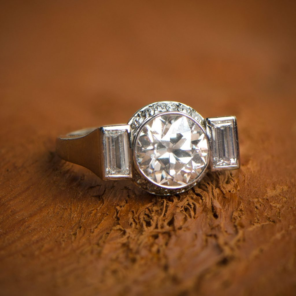 Art Deco Engagement Ring on wooden natural background