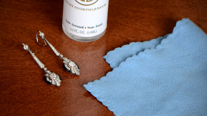 drop earrings with cleaning cloth and non toxic cleaning chemical