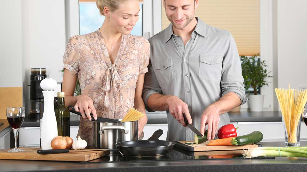 Man and girlfriend in kitchen