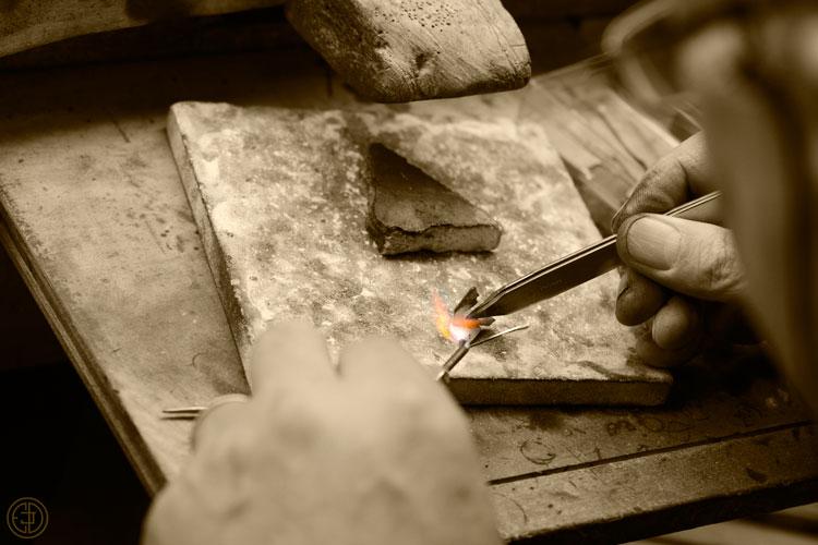 Jeweler making an engagement ring