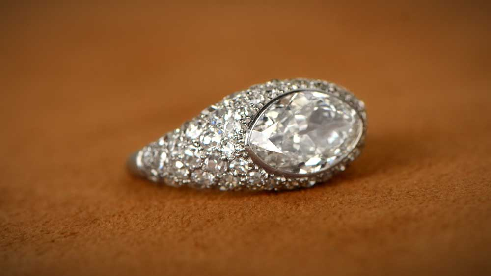 Marquise Diamond Engagement Ring on Brown Background