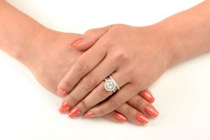 9dc74e460 You should decide if you want to wear the engagement ring on your wedding  day.