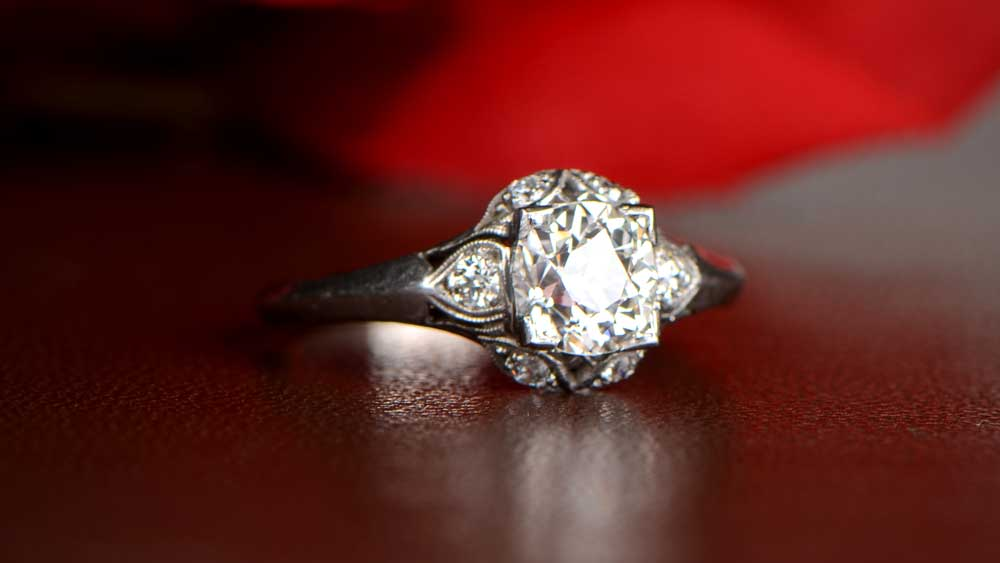 Engagement Ring with Wedding Flowers