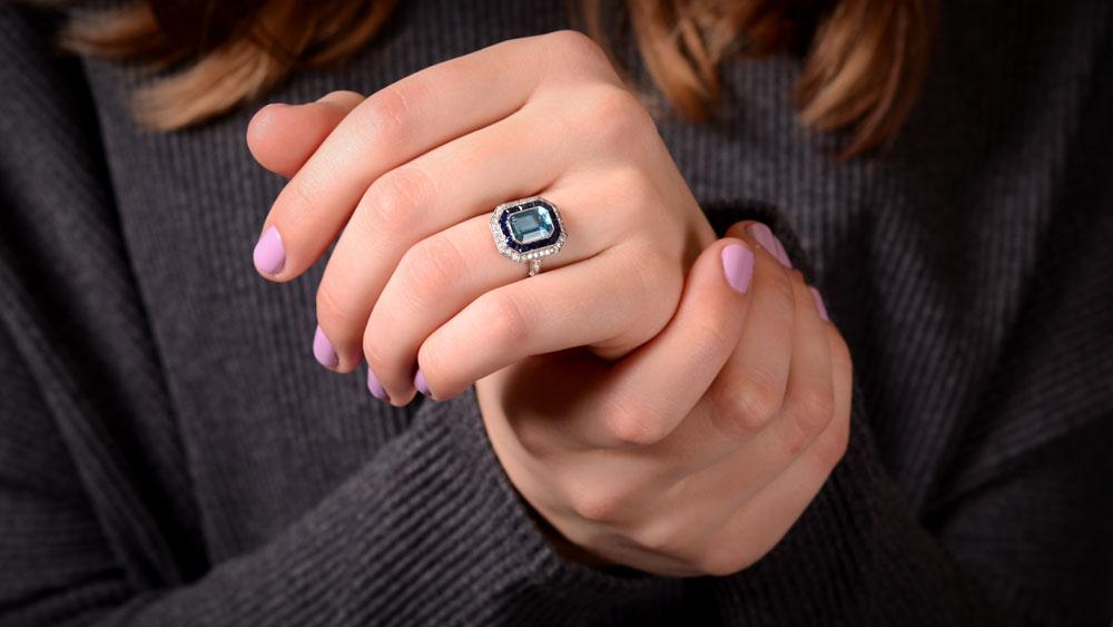 Artistic Aquamarine and Diamond Ring on Finger