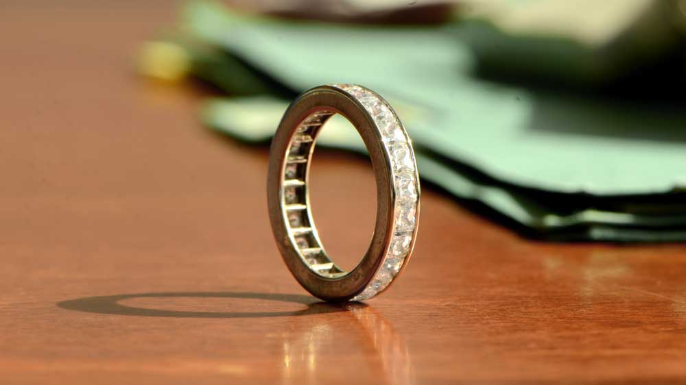 Channel Set Wedding Band on Table