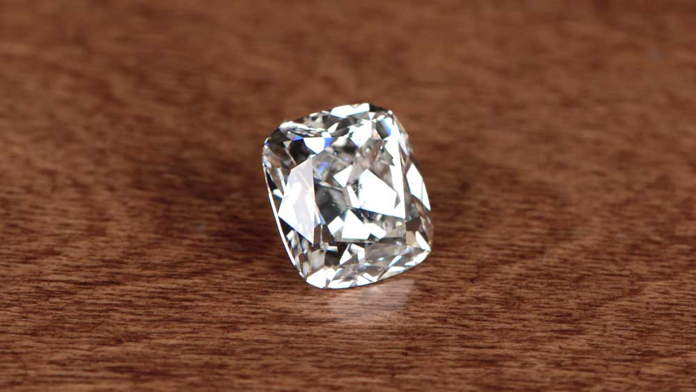 Big Cushion Cut Diamond on Table Surface