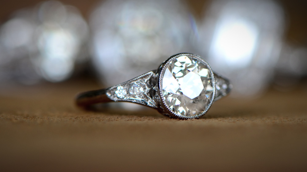 Bezel Engagement Ring with Artistic Background