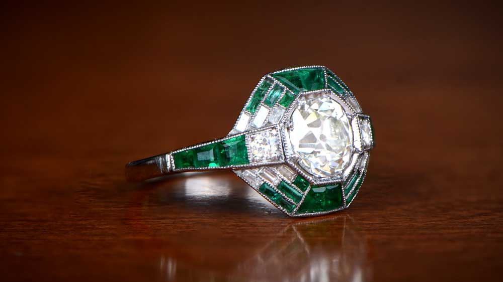 L color diamond ring with emeralds