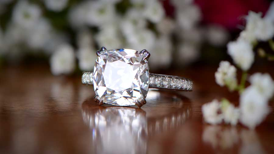 3 carat diamond engagement ring surrounded by flowers