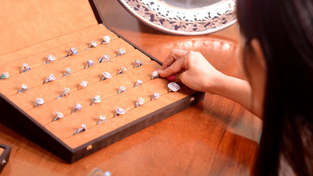 Customer Looking at Rings in Tray