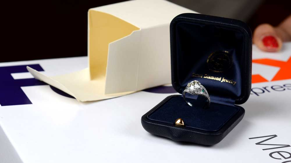 Engagement Ring on top of FedEx