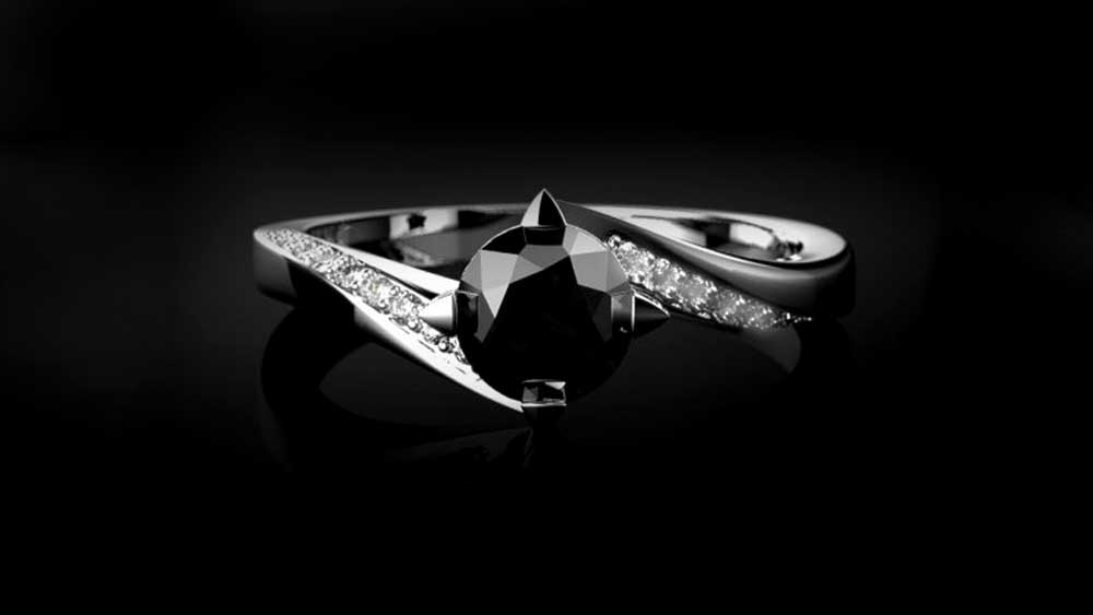 Black Diamond Engagement Ring on Black Surface