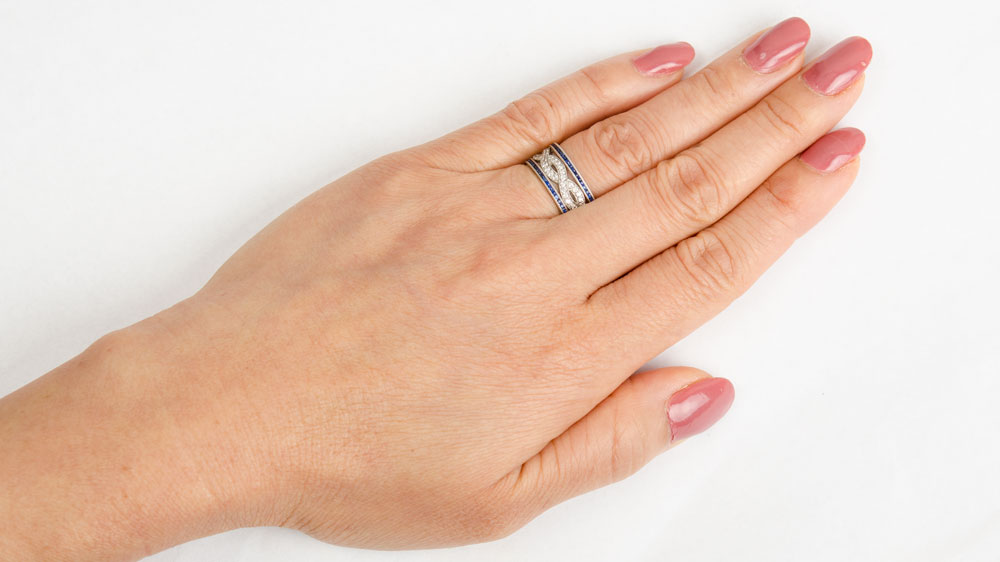 Sapphrie and Diamond Wedding Band on Finger