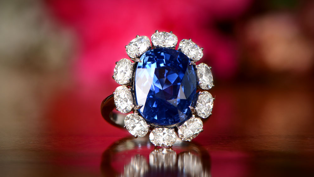 Important Sapphire Engagement Ring with Diamond Halo