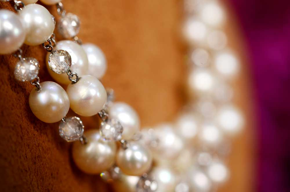 Natural Saltwater Pearl and Diamond Necklace on Stand Close Up