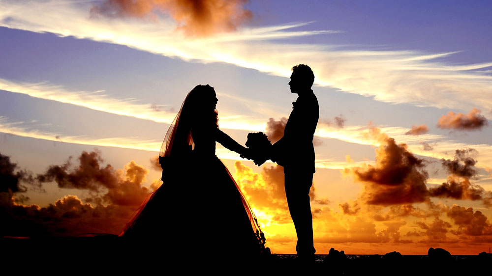 Marriage bride and groom sunset