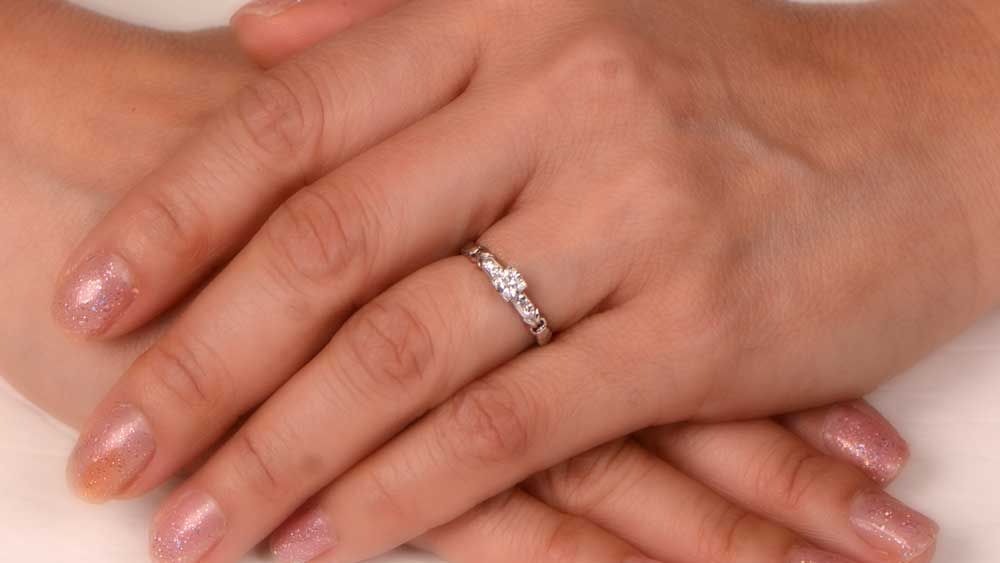 Frier Engagement Ring on Fingers