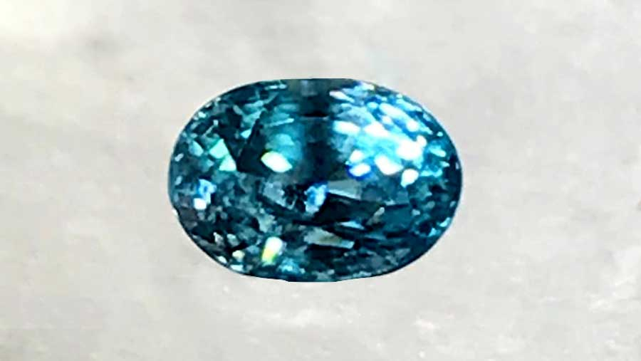 A Loose Polished and Cut Oval Cut Zircon