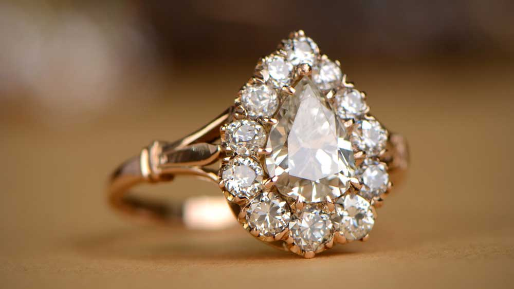 Engagement Ring with Antique Stones in Halo