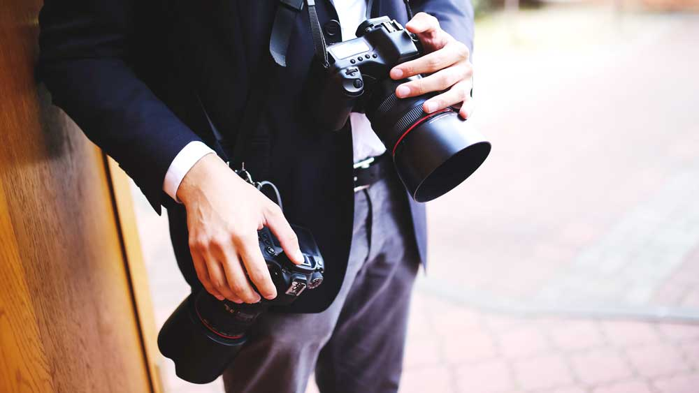Wedding Photographer with Two Cameras