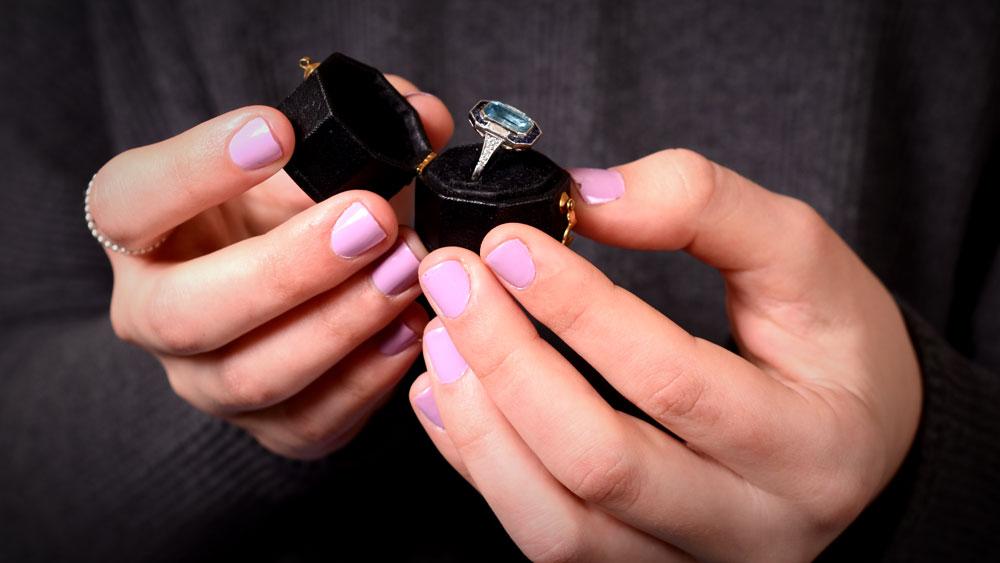 12619 Artistic Aquamarine Ring Being Held