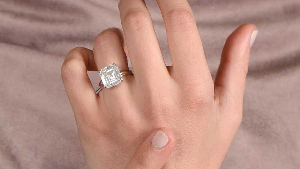 6 Carat Diamond Engagement Ring on Finger