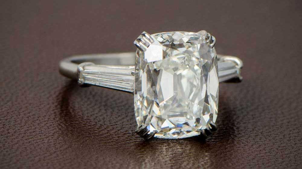 7 carat diamond ring on brown bg