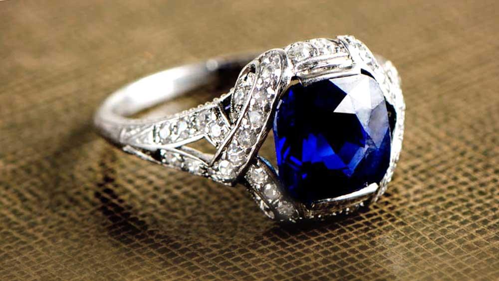 Antique 3 Carat Kashmir Sapphire Ring with Diamond Halo